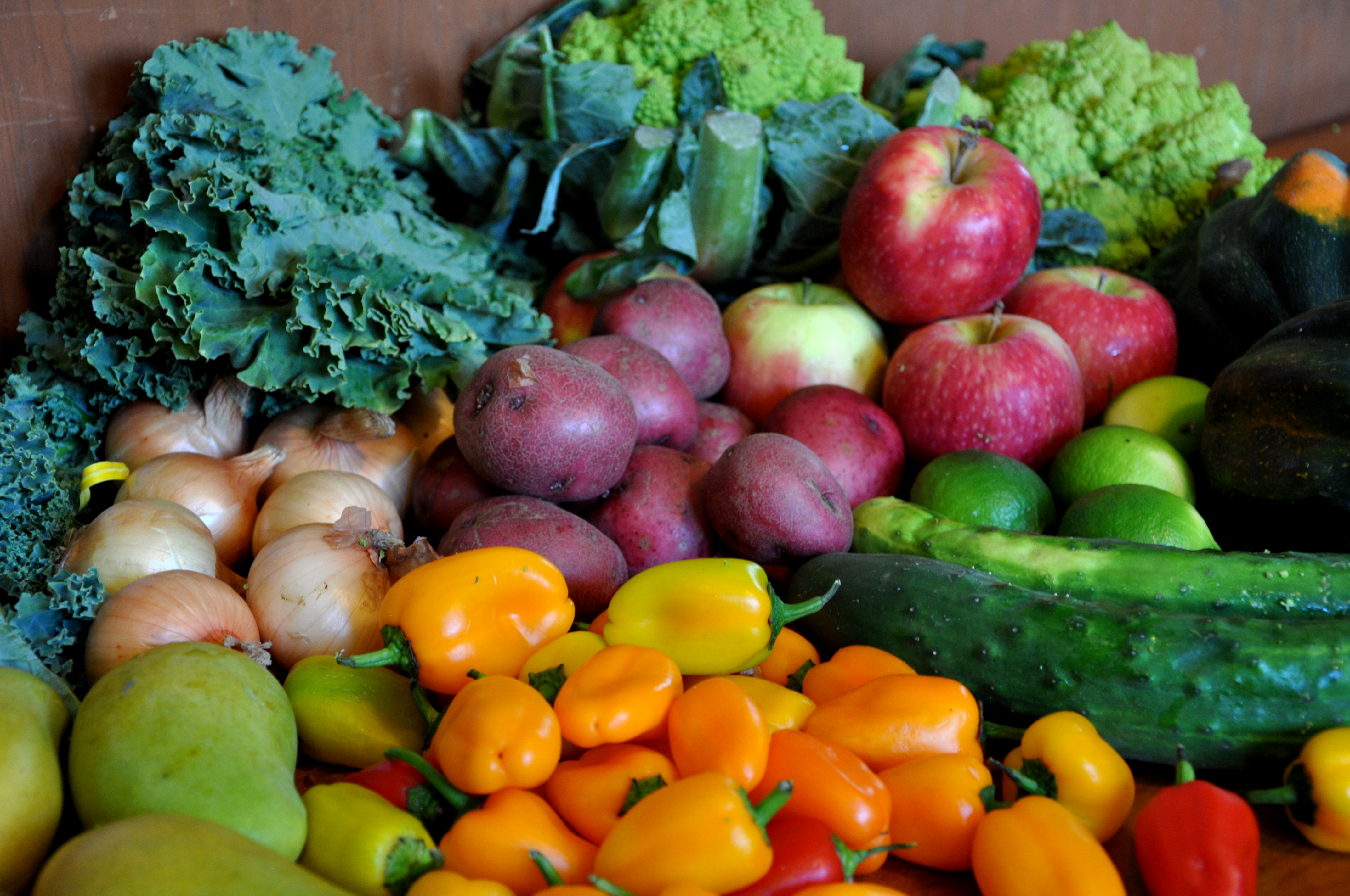 array of organic fruits and vegetables on a table