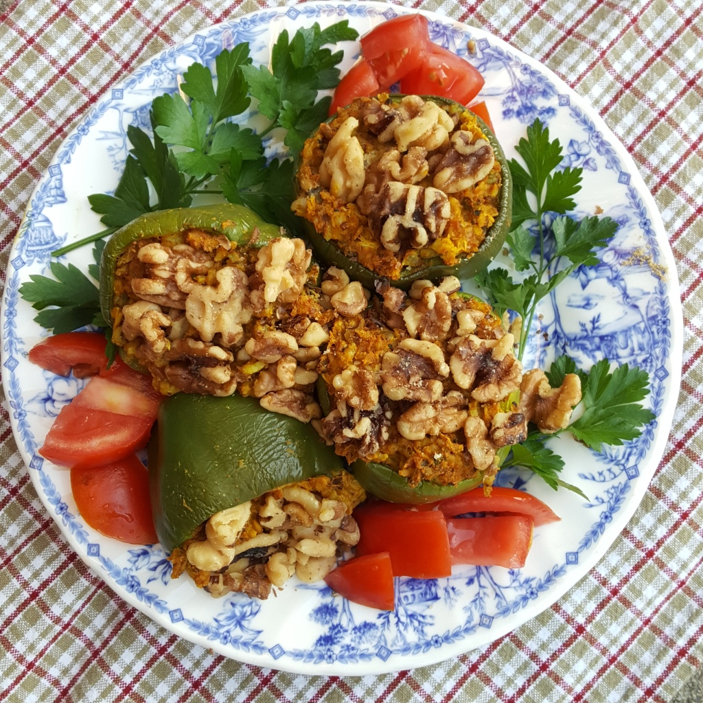 four curry stuffed peppers on a plate with garnishes