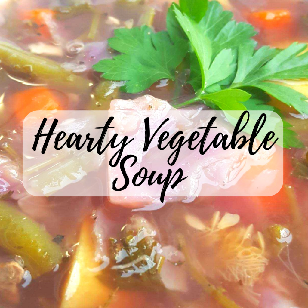hearty vegetable soup with beans, carrots, summer squash and cabbage